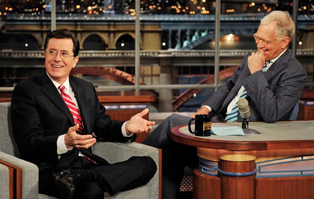 "In this May 3, 2012 photo provided by CBS, Stephen Colbert, left, host of the ""Colbert Report"" on the Comedy Central Network, has a laugh on stage with host David Letterman on the set of the ""Late Show with David Letterman,"" in New York. CBS announced on Thursday, April 10, 2014 that Colbert will replace Letterman as ""Late Show"" host after Letterman retires in 2015. (AP Photo/CBS, John Paul Filo) MANDATORY CREDIT, NO SALES, NO ARCHIVE, FOR NORTH AMERICAN USE ONLY"